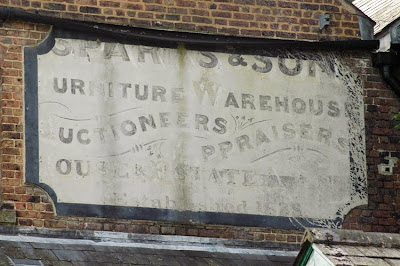 ghost sign Arundel Tarrant Street Sparks furniture warehouse actioneers appraisers estate agent