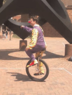 Unicycling Clown