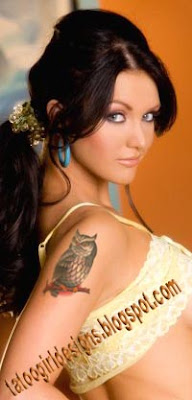 owl tattoo on the arm of sexy girl
