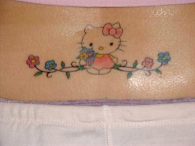 female cute lower back tattoo girl