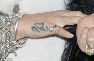 cheryl cole hands tattoos