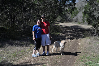 Picture of us posing in the middle of the dirt trail - even Egypt looks like she is smiling. Darrell is wearing a red shirt and light khaki shorts, I'm in a blue shirt and black yoga pants. Egypt is naked.