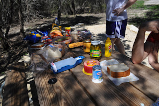 Picnic table full of all our food, we brought sandwich stuff, chips, fruits and cheese cubes lol. You can see Darrell's elbow leaning on the table and my friend Shelly standing in the background - well the bottom of her white shirt and her purple shorts.
