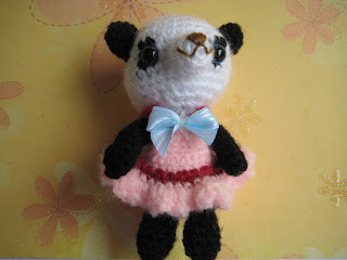 gift presents for kids: free amigurumi baby panda girl crochet pattern