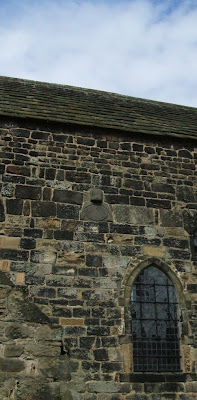 Photograph of the Saxon mass-clock on the south wall of Escombe Saxon church, near Bishop Auckland, County Durham. My photograph, April 2009.