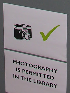 Photogrpahy is allowed in the library sign