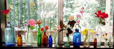 wildflowers in little colored bottles