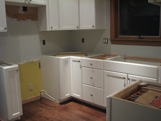 Cabinets to the left minus the stove and microwave