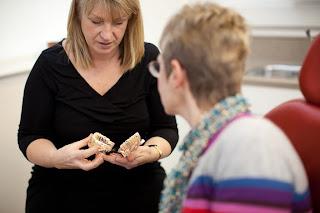 dental nurse explains dental hygiense to patient at York Place dental in Carlisle