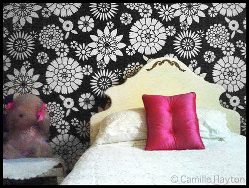 pink wallpaper room. The room looks exactly like it