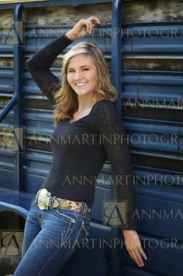 Plano East senior picture of beautiful girl posed against FFA trailer