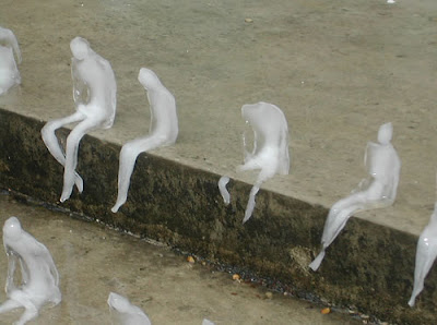 Ice Sculptures of Melting Men