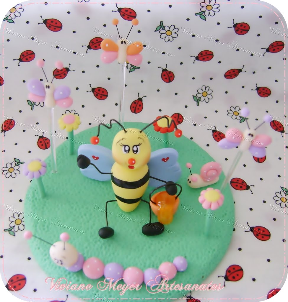 Viviane Meyer Arte em Biscuit topo de bolo jardim encantado