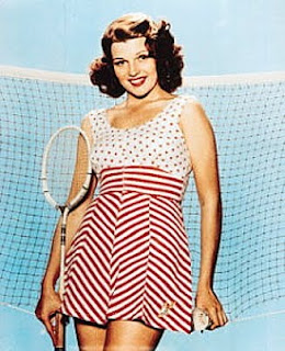 Polka dots and herringbone. Rita can get away with anything.