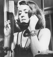 Bette Davis has 3 things you don't see nowadays: payphone, smoking, ugly costume jewelry. Oh wait... 2 things.