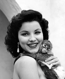 Debra Paget with an ape that isn't Elvis.