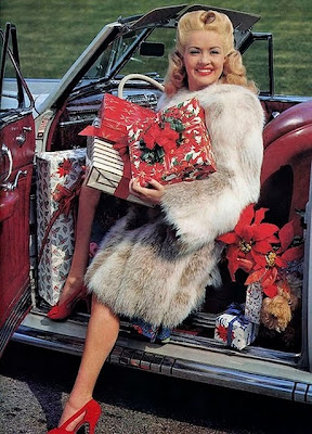 Betty Grable has more poinsettias for your cats!