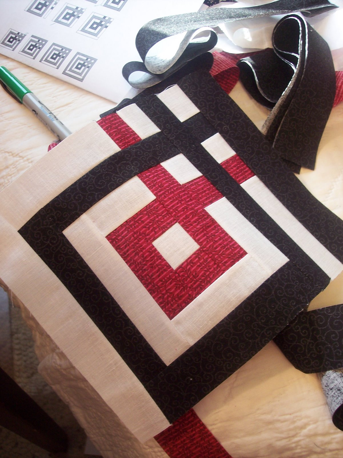 black white and red fabric made into a quilt block