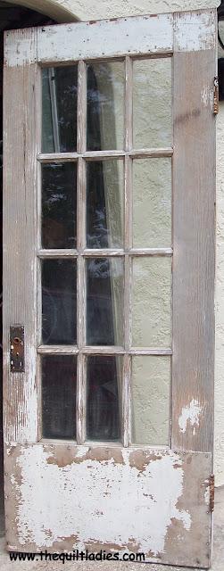 Old wooden door made into a head board