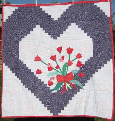 Heart quilt with applique flowers