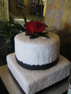 bridal shower cake black white and a touch of red theme cake this is a two tier cake each tier is three layers chocolate and vanilla with a