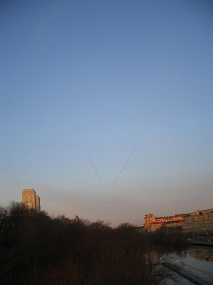 Two contrails forming a V