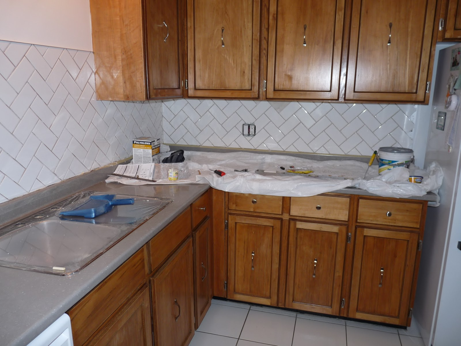 attractive Re Varnish Kitchen Cabinets #9: After the re-varnishing and onto the tiling. But look at those cabinets  gleam!