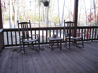 two wooden rocking chairs on my front porch