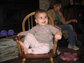 Reagan sitting in her new child rocker
