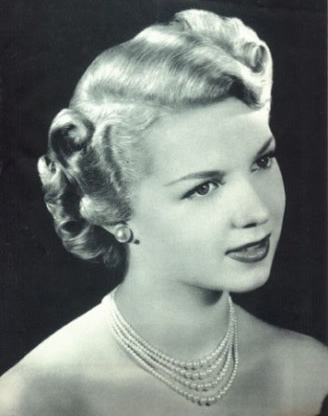 1940s hairstyles.  Victory Rolls. You know, in case I wanted to go as a Forties Housewife