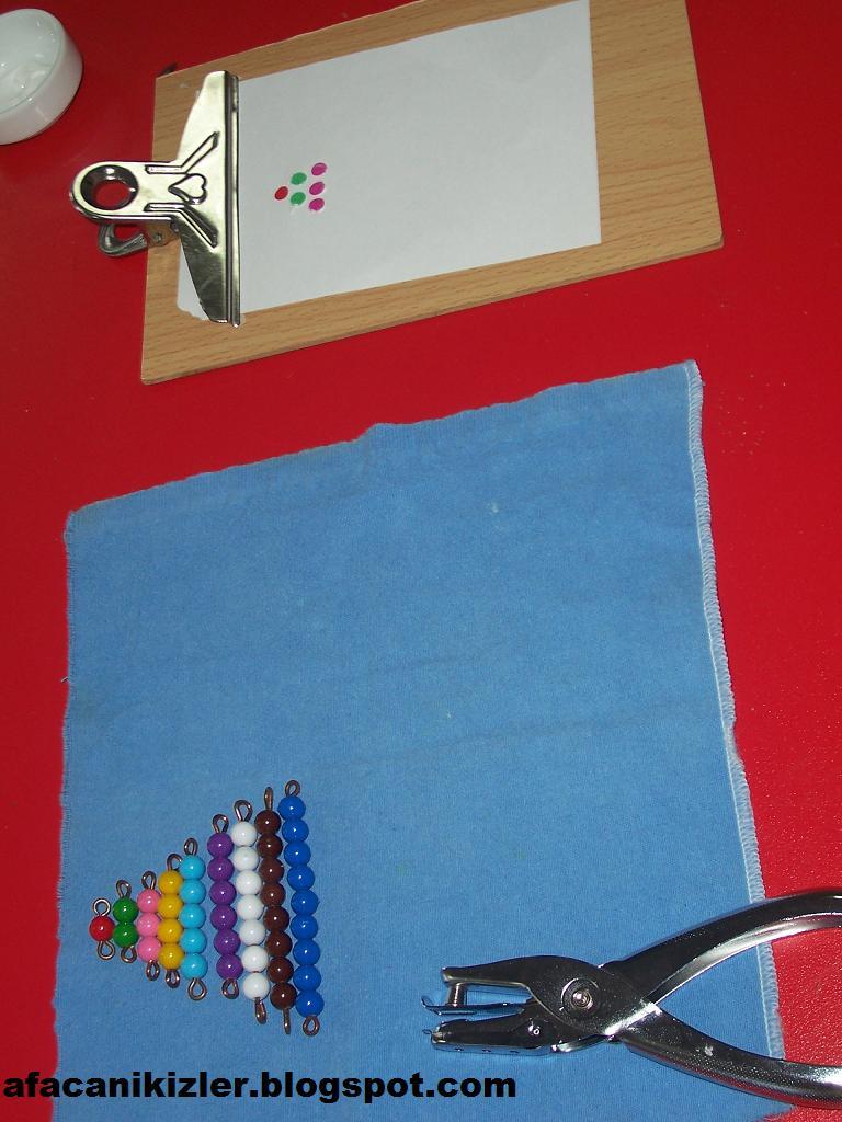Boncuklardan oluşan üçgenin aynısı renkli kalemlerle boyanır