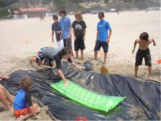 Cosmic Water Slide activity at Aloha Beach Camp at Zuma Beach Malibu.