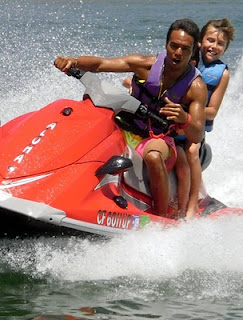 Camp counselor Tib Van Dyke gives an Aloha Beach Camp High Action summer camper a jet ski ride at Castaic Lake.