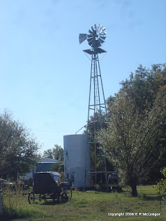 Windmill and interesting artifacts in yard