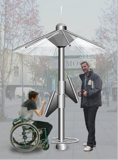 Moving on from the first picture this shows how the design is usable by all: the side view with two touch screens can vertically swivel 35 degrees around a central metal pole, a standing person can use the kiosk and also a person in a wheelchair has simultaneous access on the opposing screen which is lower. © PUBLIC DATAWEB.
