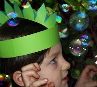 Oliver wears green T-Rex dinosaur party hat