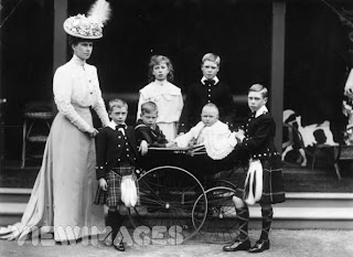 Princess Mary next to her brother Edward. Albert at far right.