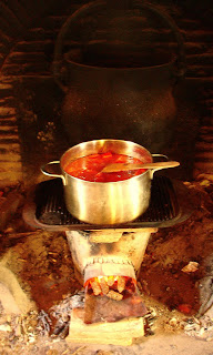 Rocket stove for cooking and water heating
