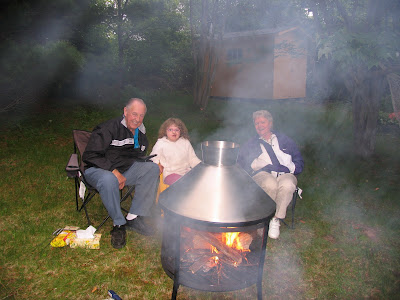 Kennedy Mom & Dad at the backyard firepit