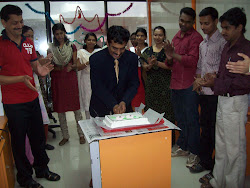 The Guest cutting the cake