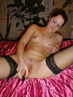 nude woman using vibrator