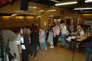 The queue for cake at the celebration of another successful KVFM community radio fortnight