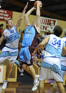 Bandit Tony Ferris puts up a shot over Blues' David Gruber