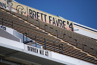Retired football number 4 worn by Brett Favre hanging on banner at Southern Miss stadium