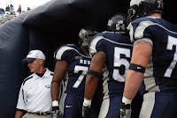 University of Nevada football players wait to take the field.