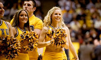Smiling University of Wyoming cheerleaders.