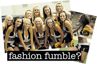University of Idaho cheerleaders smile together in group.