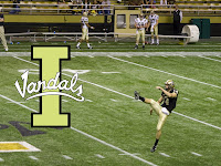 Idaho Vandals punter kicks.