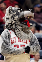 Wold mascot in New Mexico basketball uniform.