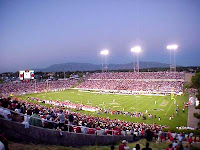 Night football game at New Mexico stadium under lights.